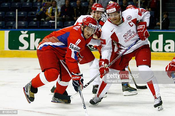 Alexander Ovechkin of Russia and Jesper Damgaard of Denmark battle for position during the IIHF World Ice Hockey Championship preliminary round at...