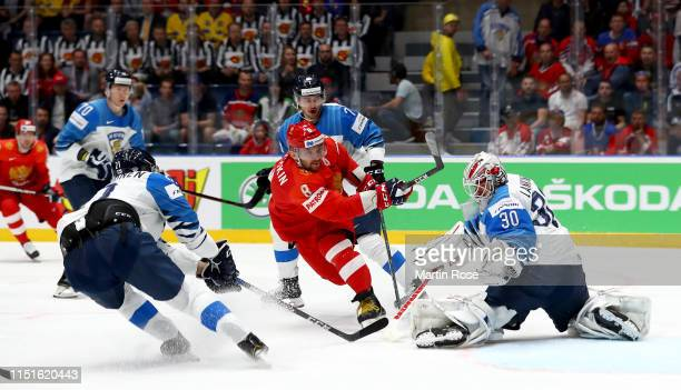 Alexander Ovechkin of Russia challenges KevinLankinen goaltender of Finland during the 2019 IIHF Ice Hockey World Championship Slovakia semi final...