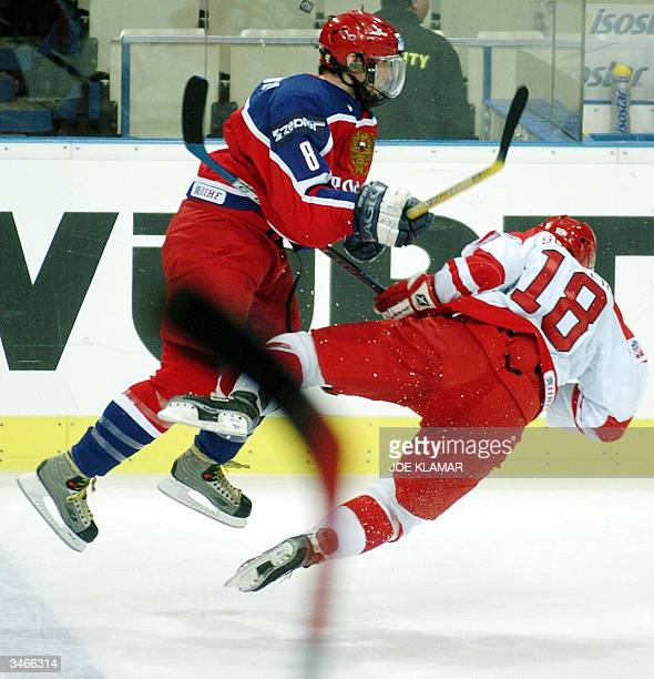Alexander Ovechkin of Russia crashes with Alexander Sundberg of Denmark goalie Maxim Sokolov during the group C preliminary round in the Ice Hockey...