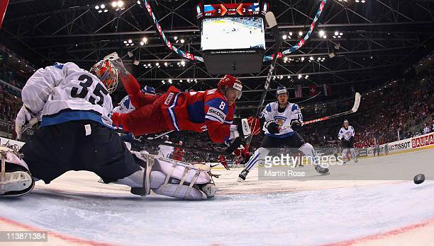 Alexander Ovechkin of Russia fails to score over Teemu Lassila , goaltender of Finland during the IIHF World Championship qualification match between...