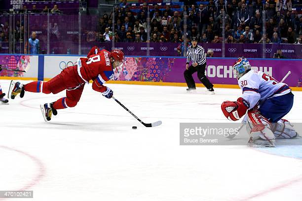 Alexander Ovechkin of Russia falls to the ice against Lars Haugen of Norway during the Men's Ice Hockey Qualification Playoff game on day eleven of...