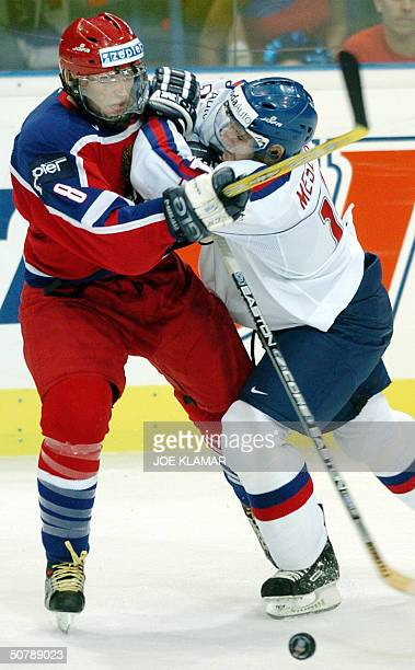 Alexander Ovechkin of Russia fights for a puck with Andrej Meszaros of Slovakia during the group F qualifing match in Ice Hockey World Championship...