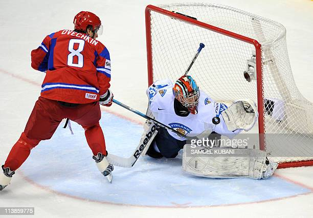 Alexander Ovechkin of Russia fights for a puck with Teemu Lassila of Finland during the IIHF Ice Hockey World Championship Qualification Round match...