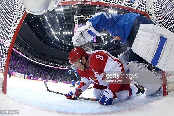 Alexander Ovechkin of Russia slides into the net of Tuukka Rask of Finland during the Men's Ice Hockey Quarterfinal Playoff on Day 12 of the 2014...