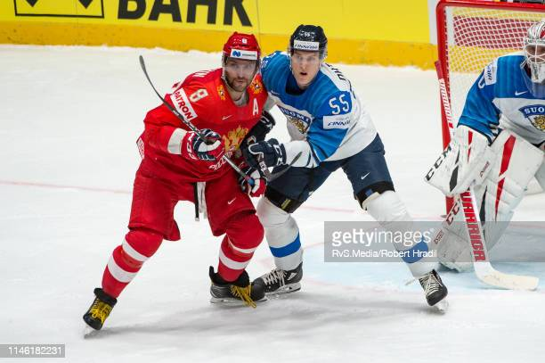 Alexander Ovechkin of Russia vies with Atte Ohtamaa of Finland during the 2019 IIHF Ice Hockey World Championship Slovakia semi final game between...