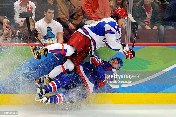 Alexander Ovechkin of Russian Federation collides with Lubos Bartecko of Slovakia during the ice hockey men's preliminary game between Slovakia and...
