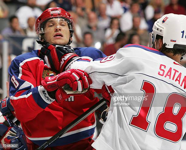 Alexander Ovechkin of Team Russia and Miroslav Satan of Team Slovakia exchange punches during the third period of their game in the World Cup of...
