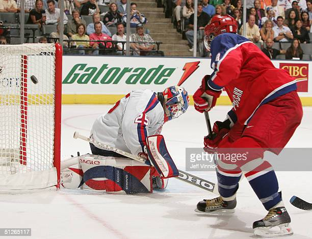 Alexander Ovechkin of Team Russia shoots the puck past the net behind Jan Lasak of Team Slovakia during the third period of their game in the World...