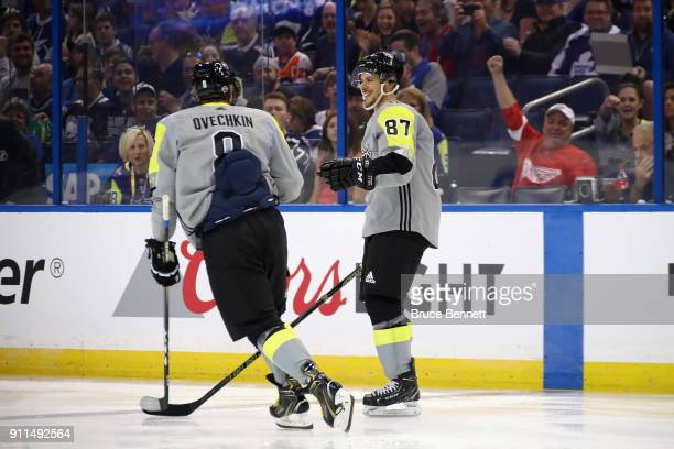 R} Alexander Ovechkin of the Washington Capitals and Sidney Crosby of the Pittsburgh Penguins react after a goal in the first half during the 2018...