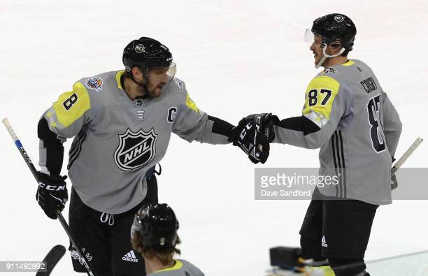Alexander Ovechkin of the Washington Capitals and Sidney Crosby of the Pittsburgh Penguins celebrate during the 2018 Honda NHL AllStar Game between...
