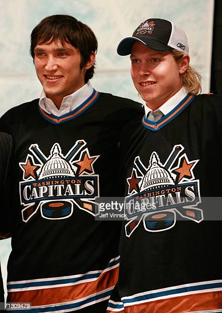 Alexander Ovechkin of the Washington Capitals poses with 4th overall pick Nicklas Backstrom of the Capitals on stage during the 2006 NHL Draft held...