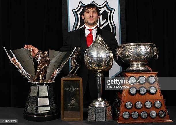 Alexander Ovechkin of the Washington Capitals poses with the Hart Memorial Trophy, the Lester B. Pearson Award, the Art Ross Trophy, and the Maurice...