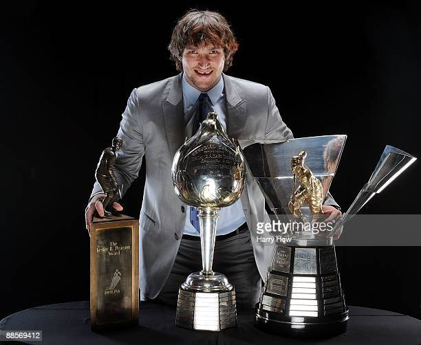 Alexander Ovechkin of the Washington Capitals poses with the Lester B. Pearson Award, the Hart Trophy and the Maurice Richard Trophy following the...