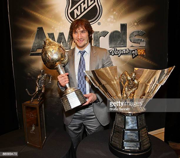 Alexander Ovechkin of the Washington Capitals poses with the Lester B Pearson Award the Hart Trophy and the Maurice Richard Trophy following the 2009...