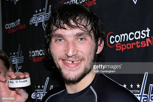 Alexander Ovechkin of the Washington Capitals poses with the puck used to score his 60th goal of the season against the Atlanta Thrashers at Philips...