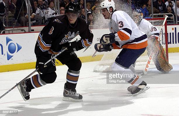 Alexander Ovechkin of the Washington Capitals spins away from defenseman Brent Sopel of the New York Islanders at the MCI Center on October 13 2005...