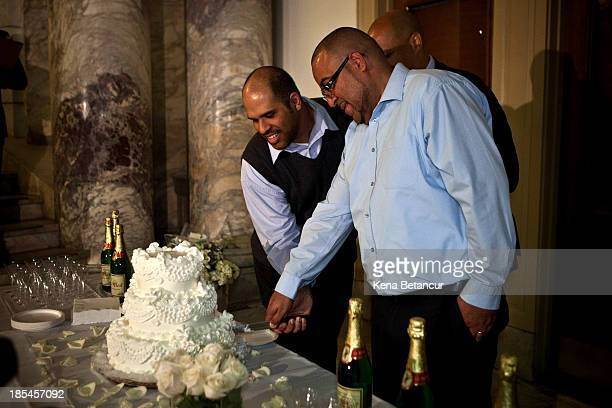 Alexander Padilla and Anthony Arenas cut a piece of cake after being married by US Senatorelect Cory Booker at City Hall in the early morning hours...