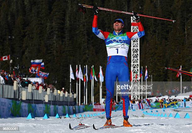 Alexander Panzhinskiy of Russia celebrates he finished second to win the silver medal in the Men's Individual Sprint C Final on day 6 of the 2010...