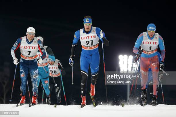 Alexander Panzhinskiy of Russia Kein Einaste of Estonia and Andrew Newell of the United States compete in the Men's 15 km Sprint Classic Quarterfinal...