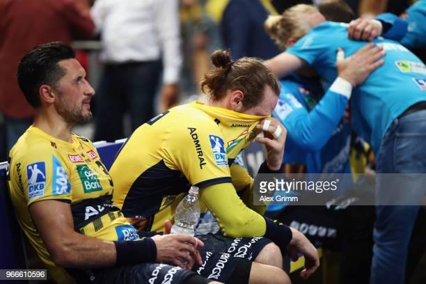 Alexander Petersson and Kim Ekdahl du Rietz of RheinNeckar Loewen react after the DKB HBL match between RheinNeckar Loewen and DHfK Leipzig at SAP...