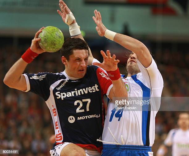 Alexander Petersson of Flensburg is challenged by Bertand Gilleo of Hamburg during the Bundesliga match between SG FlensburgHandewitt and HSV Hamburg...