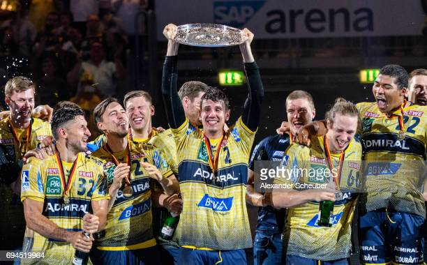 Alexander Petersson of Rhein Neckar Loewen Patrick Groetzki of Rhein Neckar Loewen and Andy Schmid of Rhein Neckar Loewen celebrate the championship...