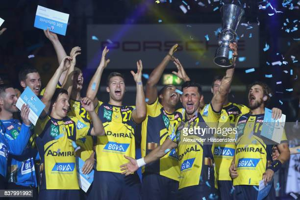 Alexander Petersson of RheinNeckar Loewen and his tzeam mates celebrate winning the Pixum DHB Handball Super Cup 2017 between RheinNeckar Loewen and...
