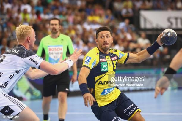 Alexander Petersson of RheinNeckar Loewen battles for the ball with Sebastian Firnhaber of Kiel during the Pixum DHB Handball Super Cup 2017 between...