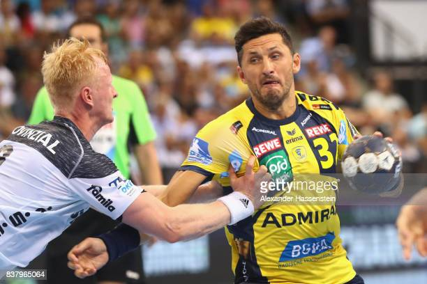 Alexander Petersson of RheinNeckar Loewen battles for the ball with Sebastian Firnhaber of Kiel during the Pixum DHB Handball Super Cup 2017 between...