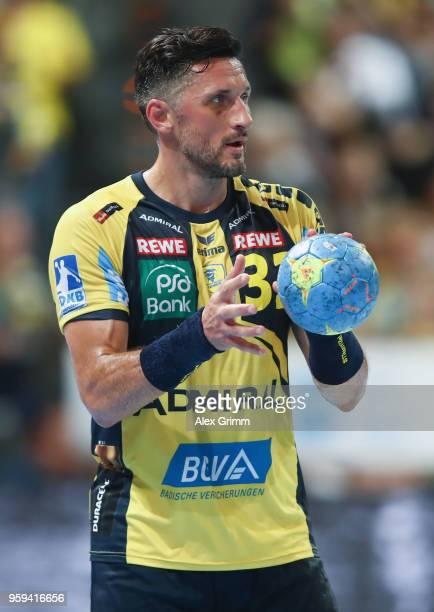 Alexander Petersson of RheinNeckar Loewen controls the ball during the DKB HBL match between RheinNeckar Loewen and SC Magdeburg at SAP Arena on May...