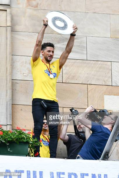 Alexander Petersson of RheinNeckar Loewen holds up the German handball championship trophy after the team won the title for the first time on the...