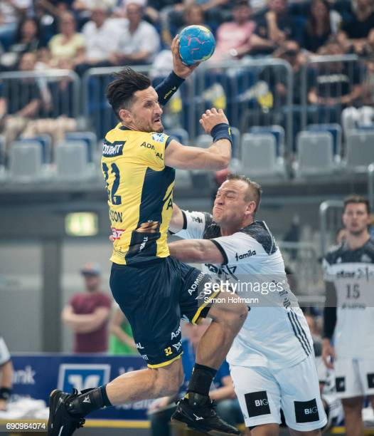 Alexander Petersson of RheinNeckar Loewen is challenged by Christian Zeitz of Kiel during the DKB HBL match between RheinNeckar Loewen and THW Kiel...