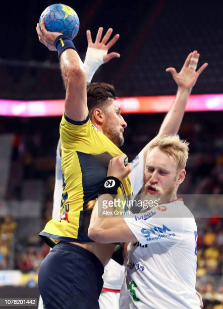 Alexander Petersson of RheinNeckar Loewen is challenged by Matthias Musche of Magdeburg during the DKB HBL match between RN Loewen and SC Magdeburg...