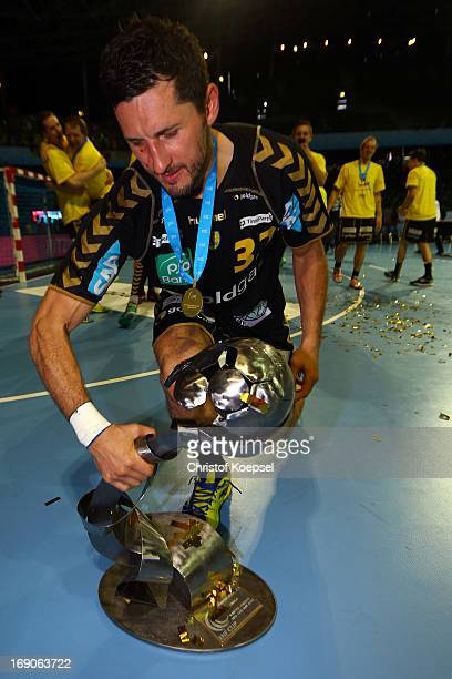 Alexander Petersson of RheinNeckar Loewen lifts the winning trophy after winning the EHF Cup Final match between HBC Nantes and and RheinNeckar...