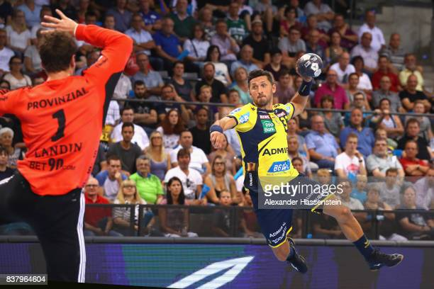 Alexander Petersson of RheinNeckar Loewen scores a goal against Niklas Landin Jacobsen keeper of of Kiel during the Pixum DHB Handball Super Cup 2017...