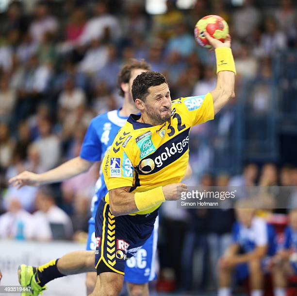 Alexander Petersson of RheinNeckar Loewen tries to score during the DKB Handball Bundesliga match between VfL Gummersbach and RheinNeckar Loewen at...