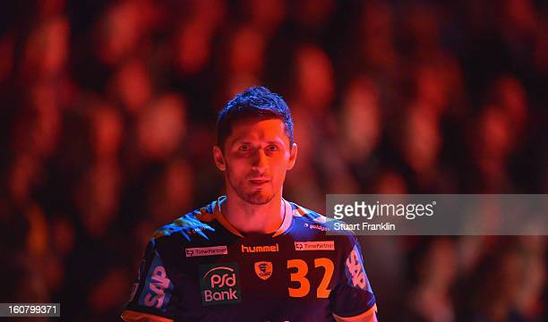 Alexander Petersson of RheinNeckar ponders during the DHB cup game between SG Flensburg Handewitt and RheinNeckar Loewen at the Flens Arena on...