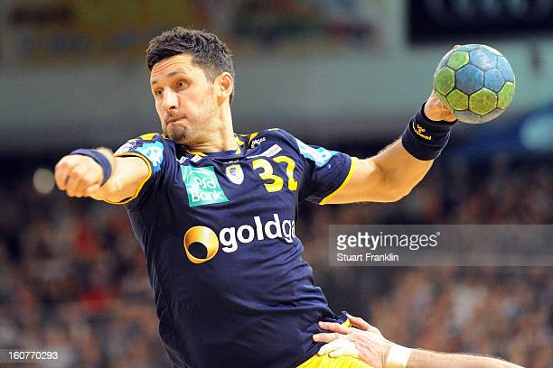 Alexander Petersson of RheinNeckar throws a goal during the DHB cup game between SG Flensburg Handewitt and RheinNeckar Loewen at the Flens Arena on...