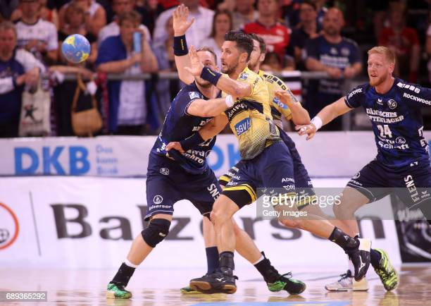 Alexander Petersson of RheinNeckarLoewen fights for the ball with Henrik Toft Hansen of SG Flensburg Handewitt during the Game SG Flensburg Handewitt...