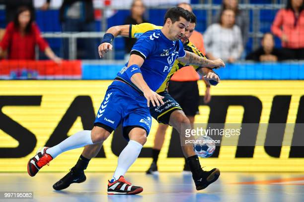 Alexander Petersson of the RheinNeckar Loewen and Zagreb's Josip Valcic vie for the ball during the handball Champions League group stage match...