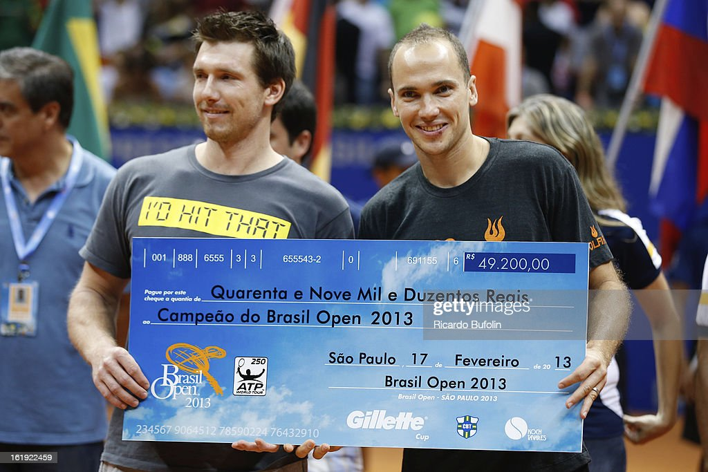Alexander Peya from Austria and Bruno Soares from Brasil pose for a photo after winning the double final match against Frantisek Cermak from Czech Republic and Michal Mertinak from Slovakia, as part of the ATP Brazil Open on February 17, 2013, at Ibirapuera Gymnasium in Sao Paulo, Brazil.