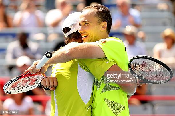 Alexander Peya of Austria and Bruno Soares of Brazil celebrate match point against Andy Murray and Colin Fleming of Great Britain during the doubles...