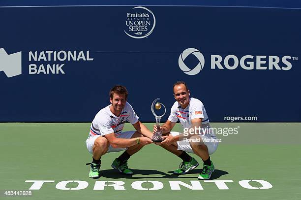 Alexander Peya of Austria and Bruno Soares of Brazil pose with the Rogers Cup trophy after their 46 36 Mens Doubles finals win against Ivan Dodig of...