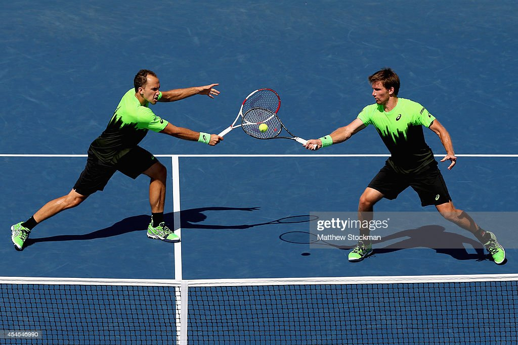 Alexander Peya of Austria and Bruno Soares of Brazil return a shot against Marcel Granollers and Marc Lopez of Spain during their men's doubles quarterfinal match on Day Ten of the 2014 US Open at the USTA Billie Jean King National Tennis Center on September 3, 2014 in the Flushing neighborhood of the Queens borough of New York City.