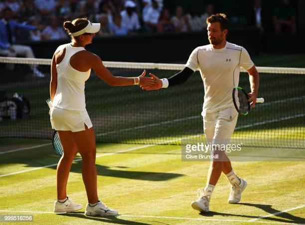 Alexander Peya of Austria and Nicole Melichar of The United States celebrates a point against Jamie Murray of Great Britain and Victoria Azarenka of...