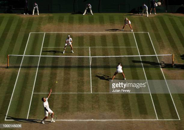 Alexander Peya of Austria and Nicole Melichar of The United States serve to Jamie Murray of Great Britain and Victoria Azarenka of Belarus during the...