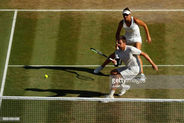 Alexander Peya of Austria and Nicole Melichar of The United States return against Jamie Murray of Great Britain and Victoria Azarenka of Belarus...