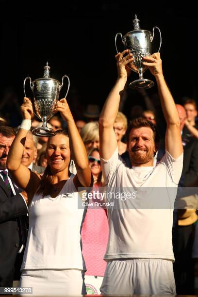 Alexander Peya of Austria and Nicole Melichar of The United States celebrate with their trophies after the Mixed Doubles final against Jamie Murray...