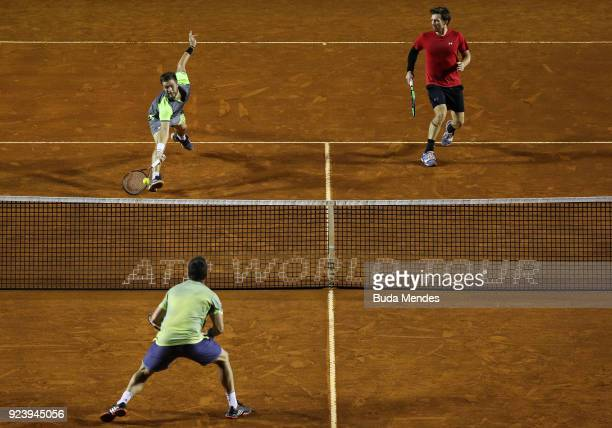 Alexander Peya of Austria and Nikola Mektic of Croatia return a shot to David Marrero and Fernando Verdasco of Spain during the doubles final of the...