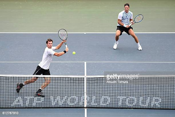 Alexander Peya of Austria and Robert Lindstedt of Sweden in action during the men's doubles first round match against Henri Kontinen of Finland and...